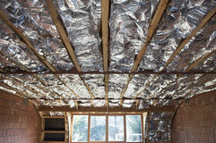 Fiberglass insulation. Installed in the sloping ceiling of a house stock image