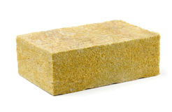 Fiberglass insulation. Piece of yellow fiberglass insulation mat isolated on white stock images