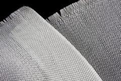 Fiberglastuch auf schwarzem backround Stockbilder