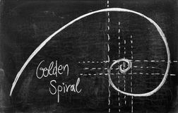 Fibonacci spiral. And golden section on blackboard Stock Image