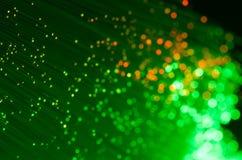 Fibras óticas verdes e alaranjadas Foto de Stock Royalty Free