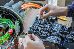 Fibre optic technician splicing fibers 2. Fibre optic technician splicing fibers. Splicing two fibers using the fusion splicer Royalty Free Stock Images