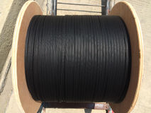 Fibre optics roll. Black outdoor for installed connections Stock Images