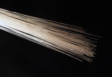 Fibre optics white. White fibre optic cables royalty free stock images