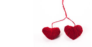 FIBRE RED HEARTS. Two crewel red hearts isolated on white Stock Image