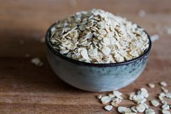 Pile of nutritious rolled oats stock photo