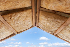 Fibreglass insulation installed in the sloping ceiling of a new frame house.  stock photo