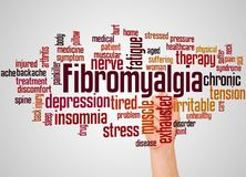 Fibromyalgia word cloud and hand with marker concept. On gradient background. Medical condition characterised by chronic widespread pain stock photography