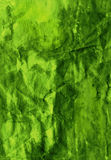 Fibrous crumpled paper. Painted crumpled green paper texture with visible fibres Stock Images