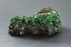 Fibrous malachite with fine sharp green crystals from Katanga Zaire. A copper carbonate hydroxide mineral that crystallizes in the monoclinic crystal system stock image