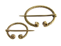 Fibula, ancient decoration. Golden fibula, ancient decoration used to buckle cloth stock images