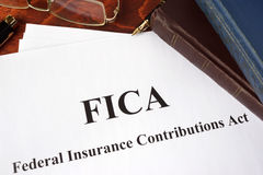 FICA Federal Insurance Contributions Act. Papers with FICA Federal Insurance Contributions Act tax Stock Image