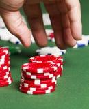 Fichas de póker del gancho agarrador Imagen de archivo libre de regalías