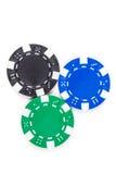 Fichas de póker negras, verdes, y azules Fotos de archivo