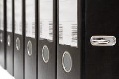 Ficheros de la palanca del arco en una fila Imágenes de archivo libres de regalías