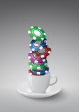 Fiches cup. Illustration of coffee cup with casino fiches Stock Photography