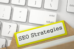 Fichier sur cartes avec l'inscription SEO Strategies 3d Photo libre de droits
