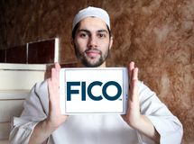 FICO data analytics company logo. Logo of FICO company on samsung tablet holded by arab muslim man. FICO is a data analytics company Stock Images