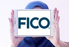 FICO data analytics company logo. Logo of FICO company on samsung tablet holded by arab muslim woman. FICO is a data analytics company stock photography