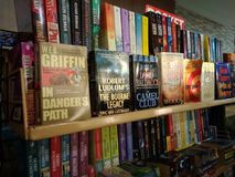 Fiction books on display. Used books for sale at a mall stall. Assorted pocketbooks to choose from royalty free stock photography