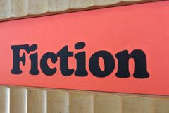 Fiction Red Sign Background on a book shelf Royalty Free Stock Image