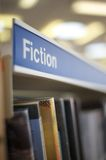 Fiction signage in library. Showing shelf Royalty Free Stock Photography