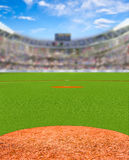 Fictitious Baseball Stadium With Copy Space. Fictitious baseball stadium full of fans in the stands with deliberate focus on foreground and shallow depth of Royalty Free Stock Image