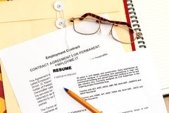 Fictitious Resume. A fictitious resume with employment contract and envelope Stock Images
