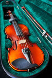 Fiddle with bow in green velvet box Royalty Free Stock Photography