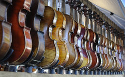 Fiddle Row. Display of Fiddles in a Row at Renaissance Fair Stock Photo