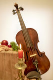 Fiddle to Christmas with candle Royalty Free Stock Photography