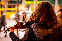 Fiddler Girl On The Street Stock Photos