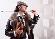 A fiddler with his instrument Stock Photography