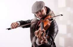 A fiddler playing his instrument Royalty Free Stock Photo