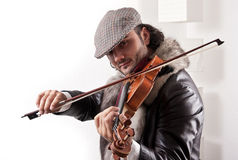 A fiddler playing his instrument Stock Photography