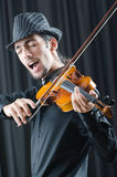 Fiddler playing the violin Stock Images