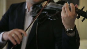 Fiddler playing the violin stock video footage
