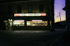 Fiddles Confectionary at night Stock Image
