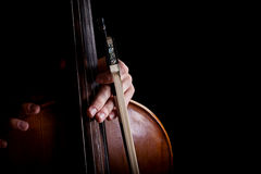 Fiddlestick in hand cellist Royalty Free Stock Images