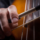 Fiddlestick. In hand cellist closeup Royalty Free Stock Images