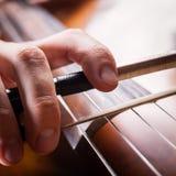 Fiddlestick. In hand cellist closeup Royalty Free Stock Photos