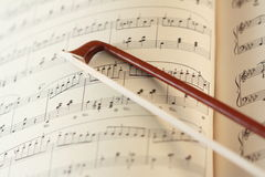 Fiddlestick and the music sheet. Fiddlestick on the music sheet Stock Images