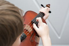 Fiddlestick on the strings of a violin Pizzicato Royalty Free Stock Photos