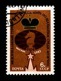 FIDE emblem, with inscription `International World Chess Championship Men - Moscow`, circa 1982. MOSCOW, RUSSIA - JUNE 26, 2017: A stamp printed in USSR Russia Stock Image