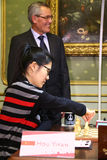 FIDE Women's World Chess Championship. LVIV, UKRAINE - MARCH 11, 2016: Hou Yifan of China prepares before the 7th game of FIDE Women's World Chess Championship Stock Images