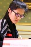 FIDE Women's World Chess Championship Match Mariya Muzychuk vs Hou Yifan. LVIV, UKRAINE - MARCH 11, 2016: Hou Yifan of China looks on during her 7th game of FIDE stock images
