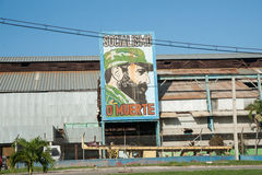 Fidel Castro billboard. Cuba Fidel Castro features on a large billboard outside and old factory in Cuba. Billboards of propaganda can be seen all around Cuba stock images