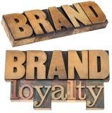 Fidelidad a la marca en el tipo de madera imagenes de archivo