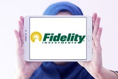 Fidelity Investments company logo. Logo of Fidelity Investments company on samsung tablet holded by arab muslim woman. Fidelity is a multinational financial Royalty Free Stock Images