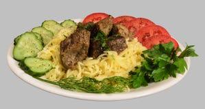 Fideos con la carne y las verduras de guisado Foto de archivo